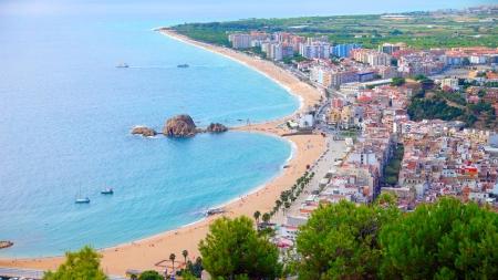 Panorama view of Blanes seaside and Sa Palomera rock in summertime. Costa Brava, Catalonia, Spain.
