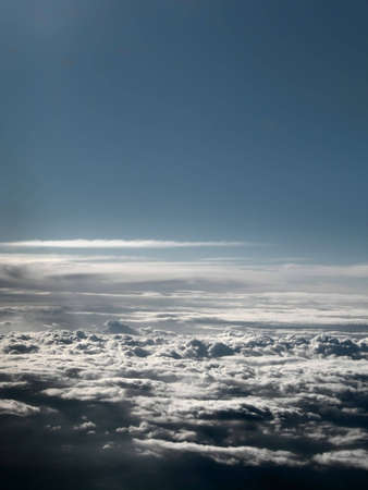 High Up, above the clouds... (Shot from inside an airplane)