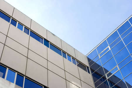 A frogview from a public Builing with reflections in the windows... Stock Photo