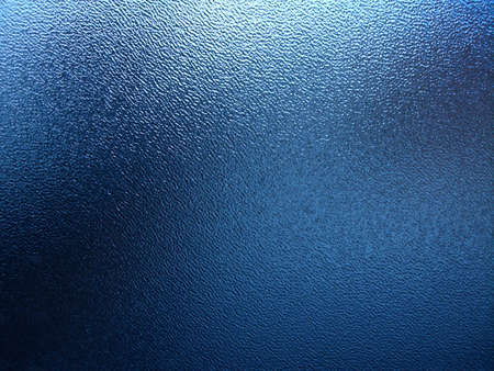 A Blue Plastic Window with Wrinkles that Look Like Water Stock Photo