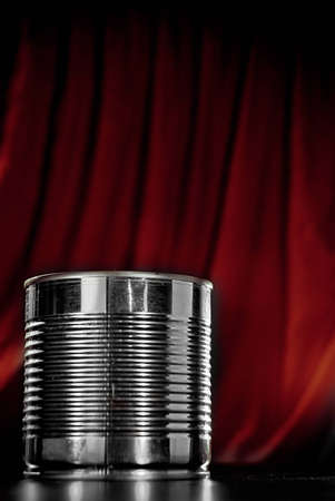 Tin Can in front of red background