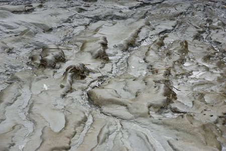 Close up of some wet mud.