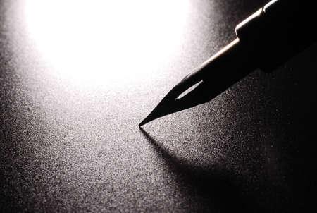 nib: A nib from a dip pen over black Stock Photo