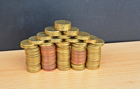 grub: house made out of coins Stock Photo