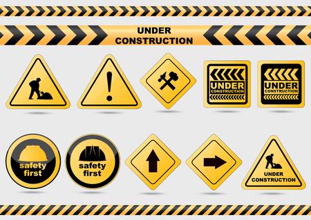 Under construction vector signs.