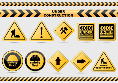 Under construction vector signs.