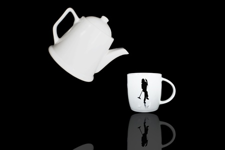 white teapot and cup with black color background Stock Photo - 9783261