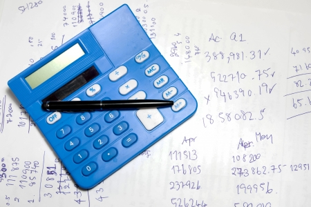 calculation concept image to show calculator with number and calculate on paper photo