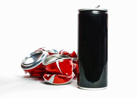 Cans of soda before squeeze and after squeeze They will  send to recycle process  Banco de Imagens