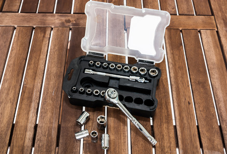 torque wrench: Image of socket wrench set on the wood slat Stock Photo