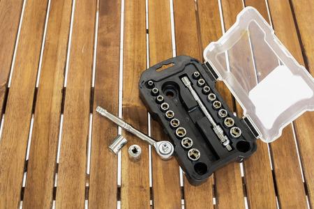 torque wrench: Background image of socket wrench set on the wood slat