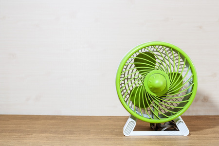 Background image of mini fan on the wood floor photo