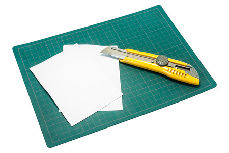 cutter: Cutter and paper on the cutter pads with white background
