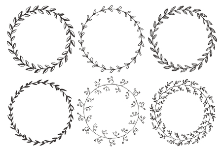 Set of hand drawn vector round floral wreaths. Stock Illustratie
