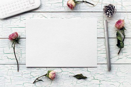 Shabby chic, Boho Mockup for presentations with dry roses. Desktop workplace designer, artist, painter top view. Modern trend template for advertising. Product mockup