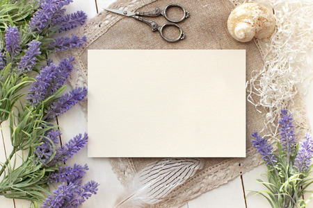Artifical lavender flowers and blank paper Mockup. Vintage style mockup for your photos and arts. French Provence european style