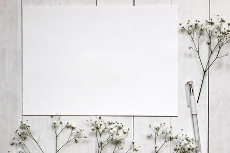 Mockup for presentations with Gypsophila flowers. Desktop workplace designer, artist, painter top view. modern trend template for advertising. Blank space for text.