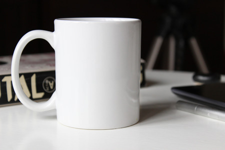 White cup, mug for Man. Mockup for designs.