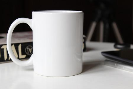 White cup, mug for Man. Mockup for designs.