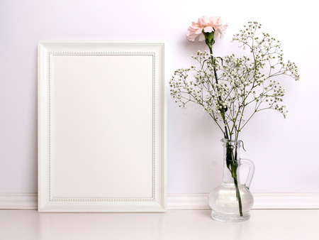 White frame mockup with flowers. Poster product design styled mock-up.