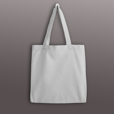 White blank cotton eco tote bag, design mockup. Handmade shopping bags. Stock Photo