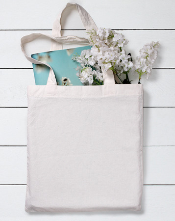 linen bag: White blank cotton eco tote bag with flowers and notebook, design mockup.