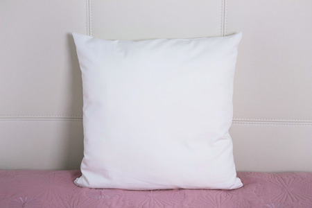 Pillow case Mockup. White pillow on bed in the bedroom. Front view.
