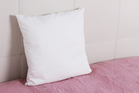 Pillow case Mockup. White pillow on bed in the bedroom. Perspective view.