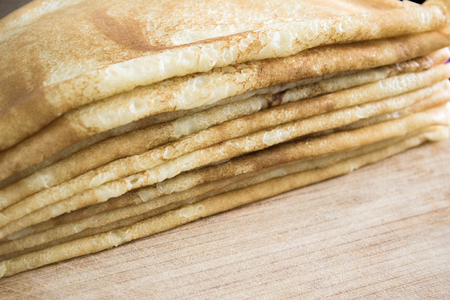 Close up of french crepes, thin pancakes on a wooden table