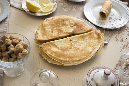 French crepes, thin pancakes on a served wooden table, tea party Banco de Imagens