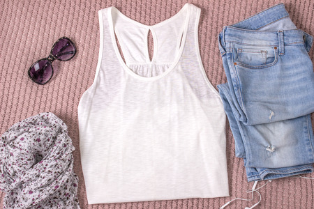 Mockup of white tank shirt with blue jeans, glasses and scarf. Summer outfit, flat lay