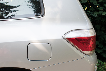 Side view of a car parked on the street with fuel opening. Mock-up for sticker or decals