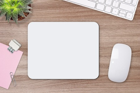Mouse pad mockup. White mat on the table with props