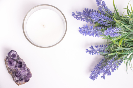 Aroma candle in glass with lavender flowers and amethyst, top view. Banco de Imagens