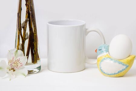Happy Easter, Mock-up of the Mug with an egg and willow in vase