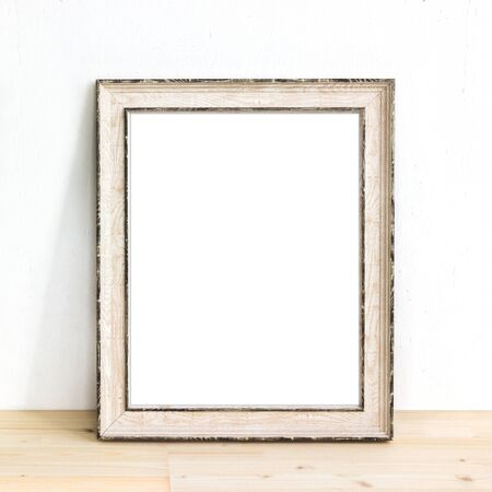 Wooden rustic picture frame standing on a table. Product mock up