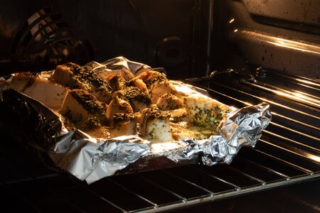 Meat with seasoning baking in the oven