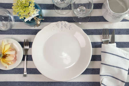 Maritime dinner menu mockup, styled photo. Plate, glasses and cutlery arranged on a table Archivio Fotografico