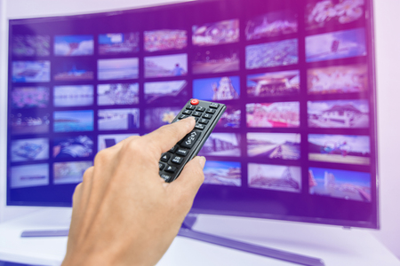 Hand pressing remote of smart tv