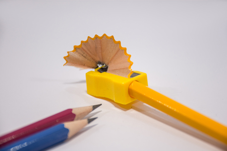 Pencil with sharpening shavings on white background,Students sharpen the pencil with a pencil sharpener Stockfoto