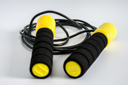yellow jump rope on white ground