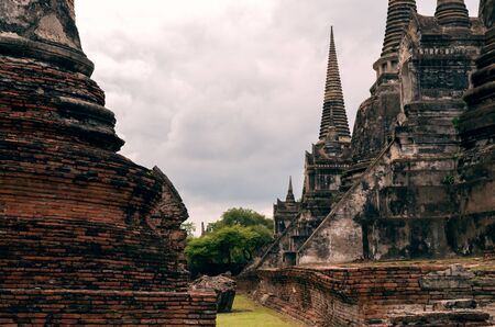 Historic City of Ayutthaya with red brick and stone facade architecture - Ancient remains of Buddhist monasteries in the old city of Siam - Travel, History and Asia concept