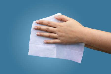female using wet antibacterial personal hygiene wipes to clean hands 版權商用圖片