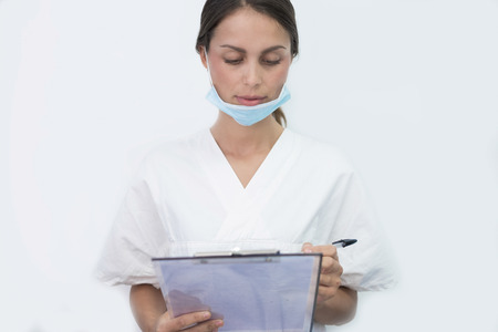 Medical assistant take notes Stock Photo