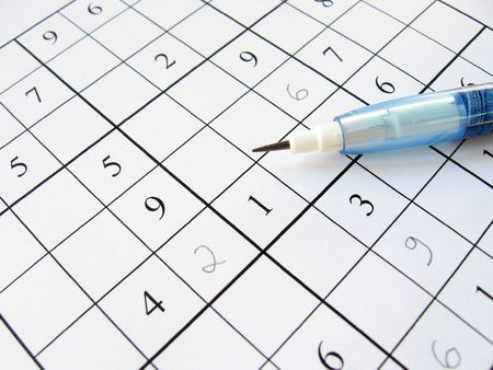 A partially filled sudoku puzzle with pencil. Stock Photo