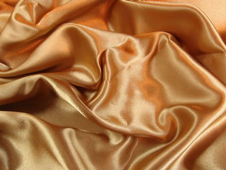A loosely laid sheet of gold satin.