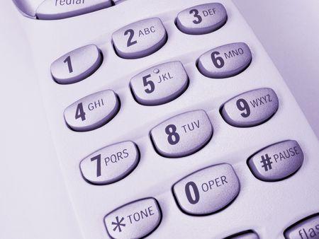 Vista ravvicinata di un telefono cordless, mostrando tastierino numerico, tonalit� porpora  Archivio Fotografico