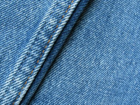 Details of the seams of a blue jeans pants.