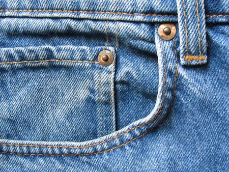 Detail of a front pocket in a blue jeans pants.