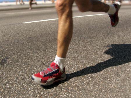Runner legs in motion at the 2006 Rio de Janeiro International Half Marathon Stock Photo